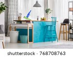 blue bar stool at painted table ...   Shutterstock . vector #768708763