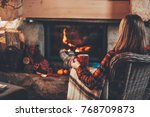 woman in warm knitted cardigan... | Shutterstock . vector #768709873