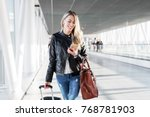 woman walking in airport and... | Shutterstock . vector #768781903