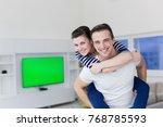 happy young man piggybacking... | Shutterstock . vector #768785593