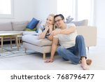 young couple on the sofa... | Shutterstock . vector #768796477