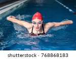 young athlete swims in the pool | Shutterstock . vector #768868183