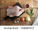 a whole raw chicken carcass... | Shutterstock . vector #768889927