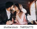 handsome indian groom dressed... | Shutterstock . vector #768926773