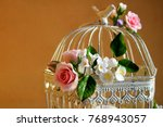 bird cage with spring blossom...   Shutterstock . vector #768943057