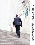 businessman in frankfurt main | Shutterstock . vector #768954877