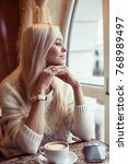 female hands hold a mug of hot... | Shutterstock . vector #768989497