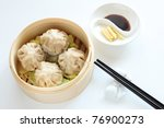 Chinese Dim Sum in bamboo steamer - stock photo