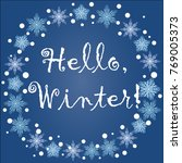 inscription hello  winter in a... | Shutterstock . vector #769005373