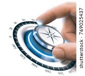 hand turning a compass knob to... | Shutterstock . vector #769025437