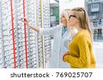 optician helping client to...   Shutterstock . vector #769025707