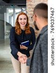 smiling redhead woman greeting...   Shutterstock . vector #769037467