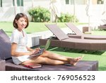 asian woman working on her... | Shutterstock . vector #769056523