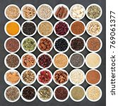 Small photo of Herbal medicine and food ingredients to maintain a healthy heart. Large collection in porcelain bowls on slate background. Top view.