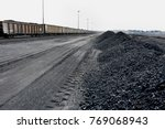 piles of coal next to a train... | Shutterstock . vector #769068943