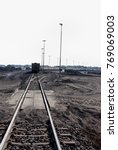 piles of coal next to a train... | Shutterstock . vector #769069003