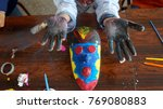 two child hands full of paint... | Shutterstock . vector #769080883