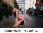 hand holding a smoothie with... | Shutterstock . vector #769106857