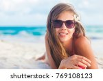 woman in bikini and straw hat... | Shutterstock . vector #769108123