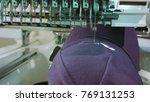 Small photo of Embroidery machine deals logo on the cap dolly shoot