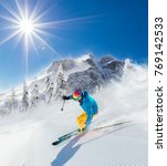 skier on piste running downhill ... | Shutterstock . vector #769142533