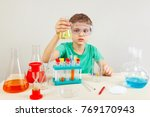 little boy in safety goggles... | Shutterstock . vector #769170943