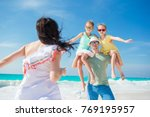 happy beautiful family on white ... | Shutterstock . vector #769195957
