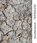 Small photo of Dry ground,Cracked ground,Cracked ground background,Dry cracked ground filling the frame as background.concept for reduce global warming.