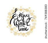 enjoy winter time inscription... | Shutterstock .eps vector #769388383