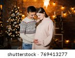 happy pregnant woman with... | Shutterstock . vector #769413277