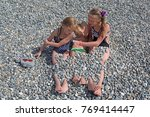 siblings have fun time on the... | Shutterstock . vector #769414447