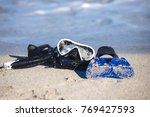 fins  a diving mask and a... | Shutterstock . vector #769427593