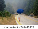 young female in a raincoat and... | Shutterstock . vector #769445497