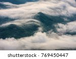 clouds moving in the mountain ... | Shutterstock . vector #769450447