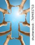 hands forming a cross against... | Shutterstock . vector #769451713