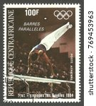 Small photo of Central African Republic - stamp printed 1984, Multicolor Air Mail issue, Topic Athletics, Series 1984 Olympic Games Los Angeles, Barres paralleles