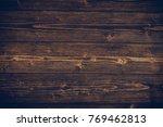 dark brown wood texture with... | Shutterstock . vector #769462813
