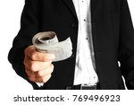 business man holding money on... | Shutterstock . vector #769496923