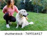 photo of brunette with labrador ... | Shutterstock . vector #769516417