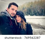 young couple taking a selfie... | Shutterstock . vector #769562287