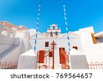 orthodox church in oia ia... | Shutterstock . vector #769564657