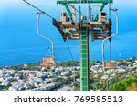 funicular cable chair above... | Shutterstock . vector #769585513
