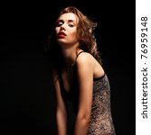 fashion girl posing on dark... | Shutterstock . vector #76959148
