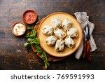 traditional steamed dumplings... | Shutterstock . vector #769591993