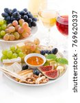 cheeses  fruits  wine and... | Shutterstock . vector #769620337