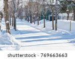 residential area with snow  ... | Shutterstock . vector #769663663