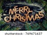 phraze merry christmas from... | Shutterstock . vector #769671637