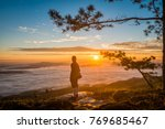 young man standing on top of...   Shutterstock . vector #769685467