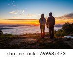 young couple standing on top of ...   Shutterstock . vector #769685473
