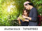 young couple tourists looking... | Shutterstock . vector #769689883